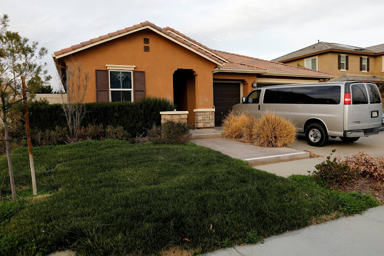 A van sits parked on the driveway of the home of David Allen Turpin and Louise Ann Turpin in Perris, California, U.S.  January 15, 2018.