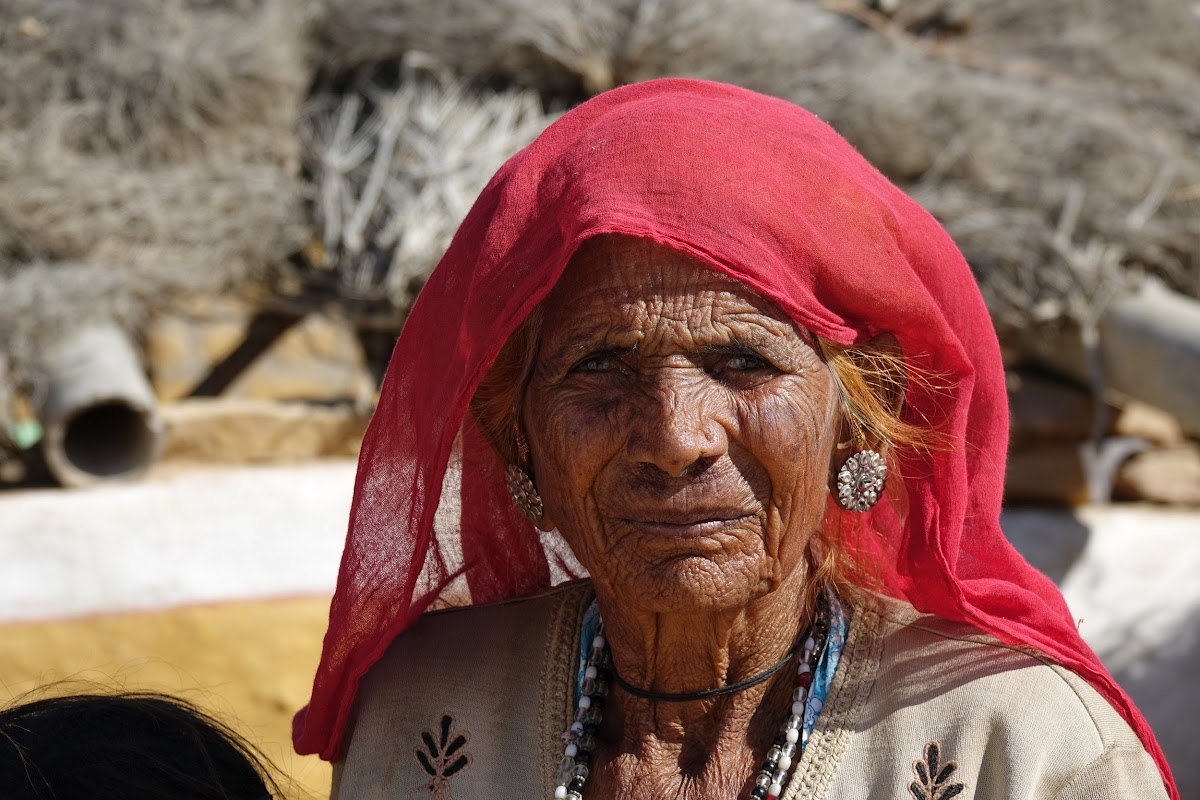 India. Rajasthan Thar Desert Camel Trek. Old lady in the village
