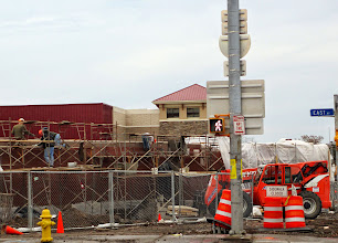 Photo: Working on the prison-wall side of Wegmans. Having their trucks come in from the S. Winton side is clever, but the guard towers are a bit disconcerting. [Note: that illusion has largely disappeared because of the plantings. My whoops.]
