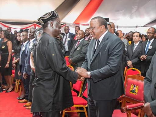 President Uhuru Kenyatta with ODM leader Raila Odinga at the burial ceremony of musician Joseph Kamaru in Murang'a on Thursday, October 11, 2018. /COURTESY