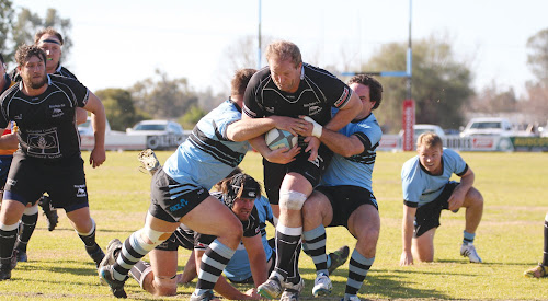 Narrabri Blue Boars Richard Hunt and Matt Schwager put the brakes on Moree's Chris Clyne during the major semi-final. The Narrabri side has one final chance to get into the grand final this weekend.