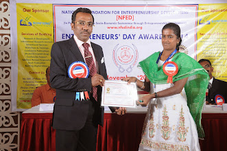 Photo: Prof. Dr. R. Ganesan, Chairman, NFED Issuing Certificate of Appreciation To Ms. Jayanthi Sundrarajan, Publishing Assistant, Bonfring, Coimbatore