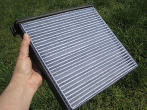 Photo: Insert the FRAM FreshBreeze Cabin Air Filter with Arm & Hammer into the frame.