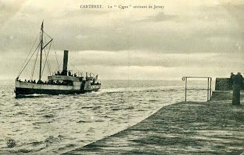 """Photo: CARTERET - Le """"Cygne"""" arrivant de Jersey. Postal stamp 1907."""