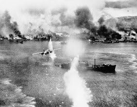 Photo: November 2, 1943: A B-25 bomber of the U.S. Army 5th Air Force strikes against a Japanese ship in the harbor at Rabaul, New Britain during an air raid on the Japanese-held air and naval base. (AP Photo)