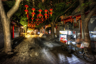 Photo: Exploring the back streets of China at night  Every alley and street is full of new sights and sounds. Here's a little HDR Tip, if you wanna... it's a little complex, but kind of handy. So, what I do is take a series of brackets at 100 ISO. That keeps everything nice and clean for processing. But, things like those red lanterns are a'swingin' around. So, I take another series at a very high ISO and low Aperture so they are nice and stable. Then, I mask them into the final photo... and I smooth out the transition so it is gradual...  #HDR  #HolyKaw