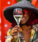Cultural influencer Kwena Baloyi enjoying a glass of champagne at the GH MUMM brunch