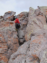 Photo: James climbing in crampons to give it a mixed rating.