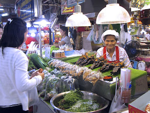 Photo: a food vendor at Or Tor Kor, one of the world's top 10 fresh markets, Bangkok