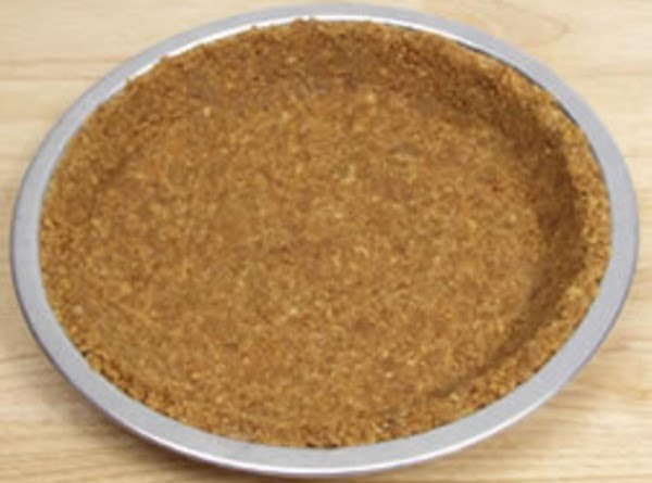 Combine crushed grahm crackers, sugar, and butter. Place in the bottom of pie pan...