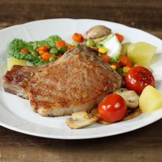 Baked Pork Chops With Vegetables & Potatoes.