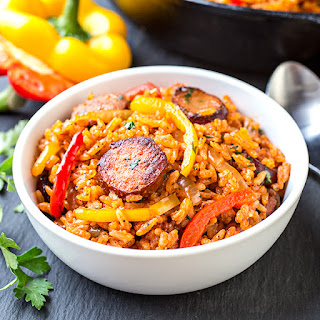 Smoked Sausage and Red Rice Skillet with Charred Onions and Peppers.