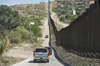 Photo: U.S. Border Patrol vehicles carrying representatives of the U.S. Conference of Catholic Bishops travel along the fence separating Mexico and the U.S. March 31 near Nogales, Ariz. A group of U.S. bishops made a two-day visit to the border region to celebrate a Mass, visit with migrants and renew their calls for changes in the U.S. immigration system. (CNS photo/Nancy Wiechec) (April 1, 2014)  (CNS photo/Nancy Wiechec) (April 1, 2014)