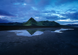 Photo: I keep plenty of images unprocessed. They simply need more time to be discovered and understood. This one also resided in my archive for good couple of months until I realized that its essence may be the closest interpretation of my frame of mind for Iceland. The volcanic massif reminds an ancient sphinx, centrally based composition and reflections emphasize stillness and peace. So does the night falling on the landscape. Photographed when we reached the end of one of dirt roads near Landmannalaugar.  http://www.landandcolors.com/2012/03/iceland-calling/