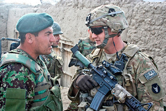 Photo: LAGHMAN PROVINCE, Afghanistan – Afghan National Army Lt. Rastum (left), 1st Company, 1st Battalion, 201st ANA Regiment, and U.S. Army 1st Lt. John Dundee, 1st platoon leader for Company A, 1st Battalion, 133rd Infantry Regiment, from Waterloo, Iowa, talk during a key leader engagement Dec. 26 in the village of Ghaziabad. (Photo by U.S. Army Staff Sgt. Ryan C. Matson, Task Force Red Bulls)