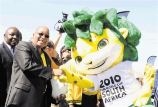 President Jacob Zuma with Zakumi at the 50 days countdown to FIFA world cup celebrations hosted by South Africa in June and July 2010.