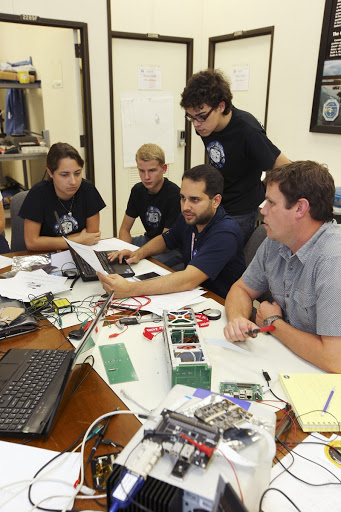 Students from California Polytechnic Institute or CalPoly and Merritt Island High School perform integration tests.