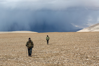Photo: Well, BC wasn't just around the corner after lunch; we traverse a high plain en route to Lungser Kangri BC with a storm behind us that never did hit. Olivier and Garry.