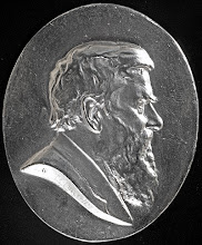 Photo: The silver Wallace Medal of the A. R. Wallace Memorial Fund, which is awarded for outstanding contributions to Wallace scholarship or the public understanding of his life and work. Photograph by George Beccaloni, but image is in public domain.