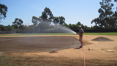 Photo: After Ron finished laser infield root-zone I am watering to make sure all gets set in