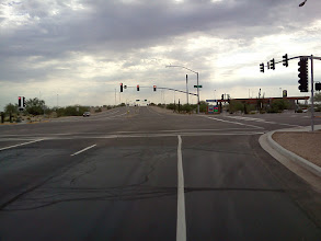 Photo: (Pic1) Two through lanes with edgeline painted all the way to intersection; and very wide shoulder to the right of edgeline (NOT a right-turn-only lane). Where may a bicyclist ride (when going straight ahead) in order to not be in violation of 28-815A?  Also where must the driver of a vehicle (that is, either a motorist, or a bicyclist) ride/drive in order to be in compliane with 29-751?  28-751. Required position and method of turning. The driver of a vehicle intending to turn shall do so as follows: 1. Right turns. Both the approach for a right turn and a right turn shall be made as close as practicable to the right-hand curb or edge of the roadway...