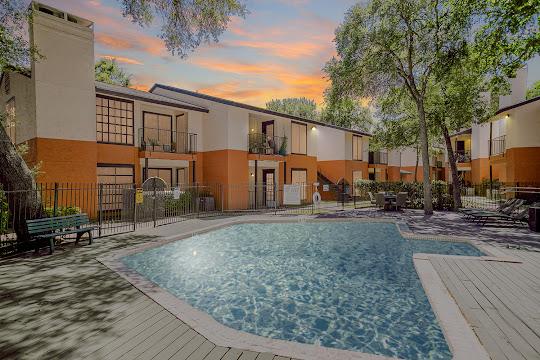 Parkside Apartments sparkling community pool at dusk