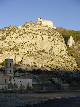 Photo: The view from the Entrevaux station, looking up 500 feet to the fortress above the old town. The road up can be seen zig-zagging along the white posts, which are actually the sides of the gates along the way.