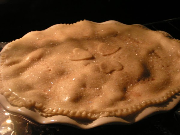 Pour into 9-inch, pie crust lined, deep dish pie plate; top with crust and...