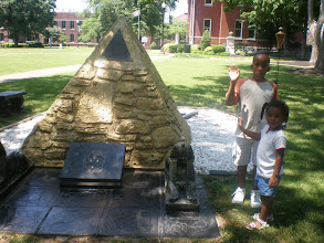 Photo: Jihad & Kaleya wave from the Alpha Phi Alpha pyramid