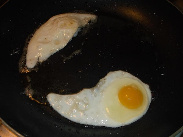 Turn eggs over when whites are mostly cooked; fry second side for approximately 30...
