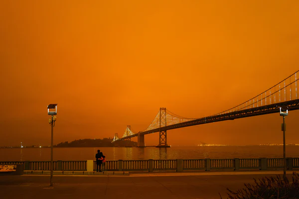 Bridge with orange sky