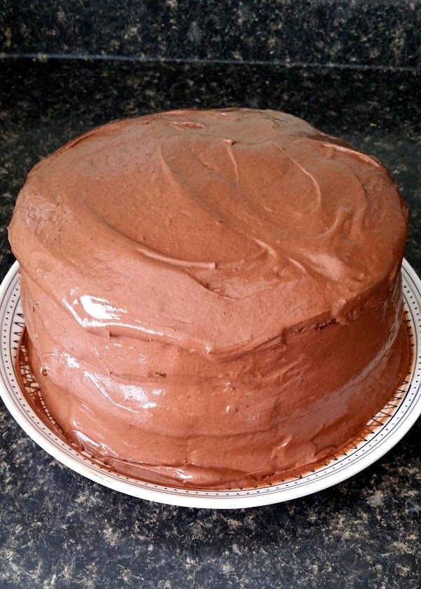 Frost the sides and top of stacked cake.