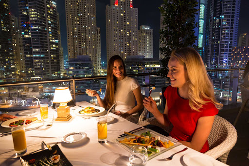 Enjoy late night dining with friends in Dubai.