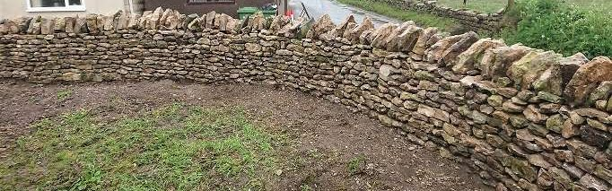 wall rebuilt to full height on a corner in Ston Easton