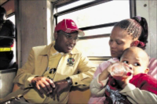 STRONG VIEWS: Cope leader Mvume Dandala and Annalien Swarts with her baby Valentino during his campaign in trains between Pretoria and Joburg. 01/04/2009. 9 Sowetan. Pic. Antonio Muchave.