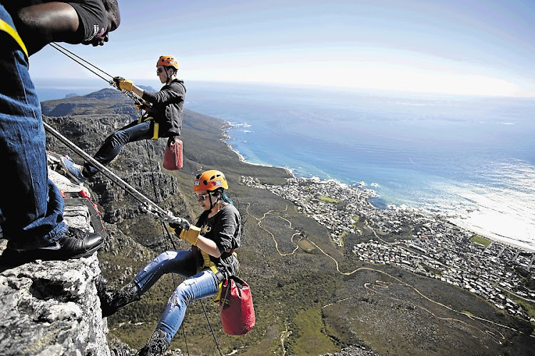 Visitors abseil from the top of Table Mountain. Picture: SUNDAY TIMES