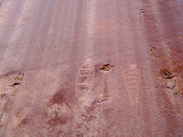 Petroglyphs high on the canyon wall