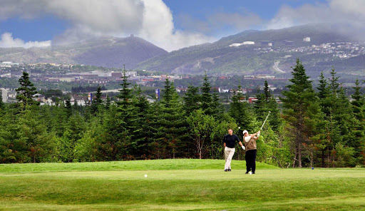 Take in stunning views of the surrounding mountains when golfing on Avalon Peninsula in Newfoundland.