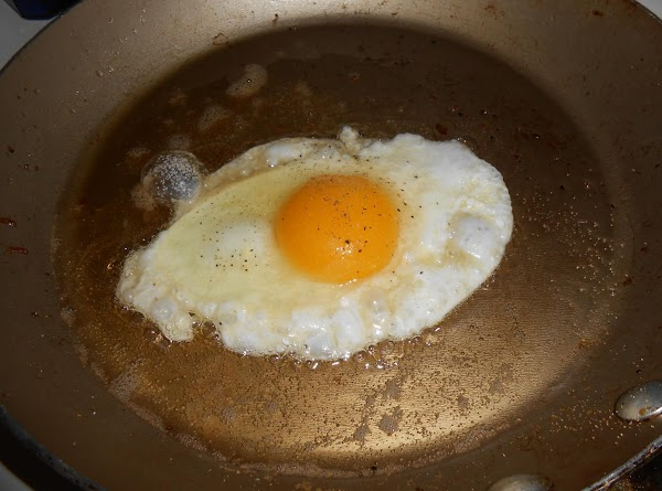 In the same skillet, carefully break the eggs into the hot bacon drippings and...