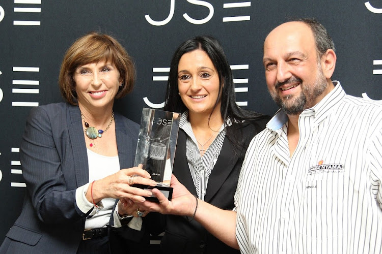 AltX:  Donna Oosthuyse from the JSE; Praxia Nathanael, Gold Brands Investments CEO and chief operating officer, Stylianos Nathanael, at the group's listing. Picture: MARTIN RHODES