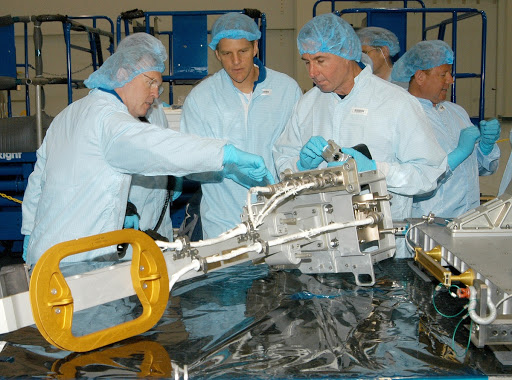 Members of several Space Shuttle mission crews get a close look at the Video Stanchion Support Assembly.