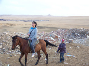Photo: Lady on horseback.  I like horses better than camels, I think.
