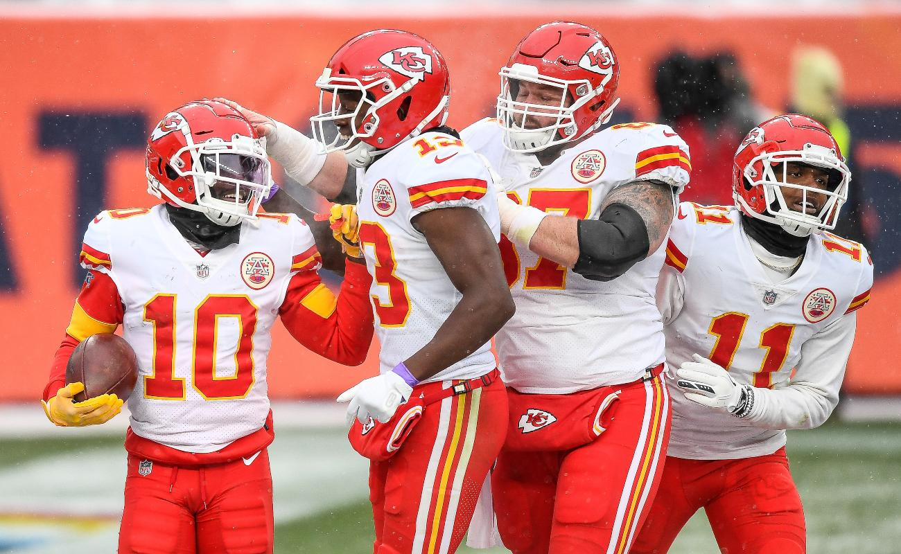 Tyreek Hill #10 of the Kansas City Chiefs celebrates a fourth quarter touchdown with teammates Byron Pringle #13, Daniel Kilgore #67, and Demarcus Robinson #11 during a game against the Denver Broncos at Empower Field at Mile High on October 25, 2020 in Denver, Colorado. (Photo by Dustin Bradford/Getty Images)