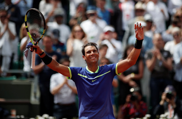 Spain's Rafael Nadal celebrates winning his fourth round match against Spain's Roberto Bautista Agut at  the French Open on Sunday. Picture: REUTERS