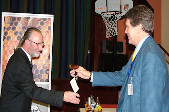 Photo: Tim Lovett receives a gift from INIB.