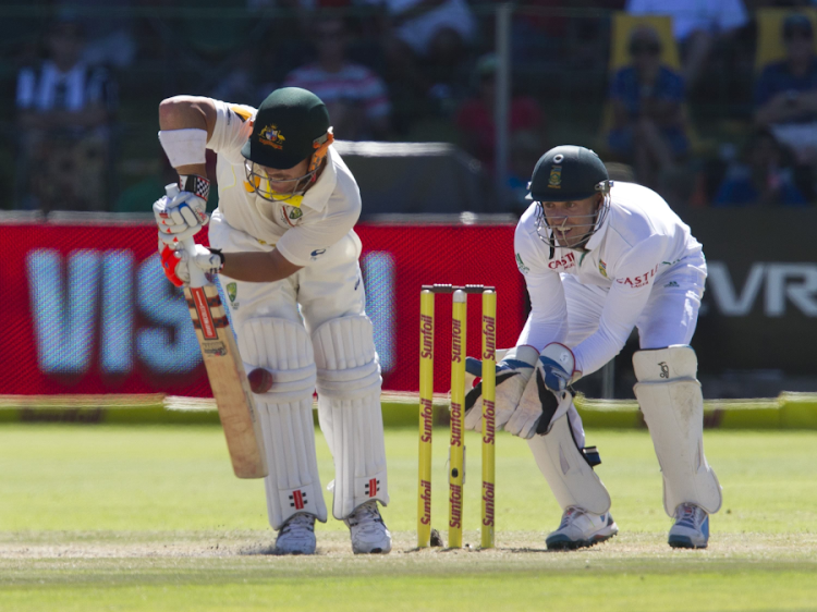 Australia's Dave Warner is trapped leg before wicket as SA's AB de Villiers looks on during the fourth day of the second cricket Test at St George's Park in Port Elizabeth. Picture: REUTERS/ROGAN WARD