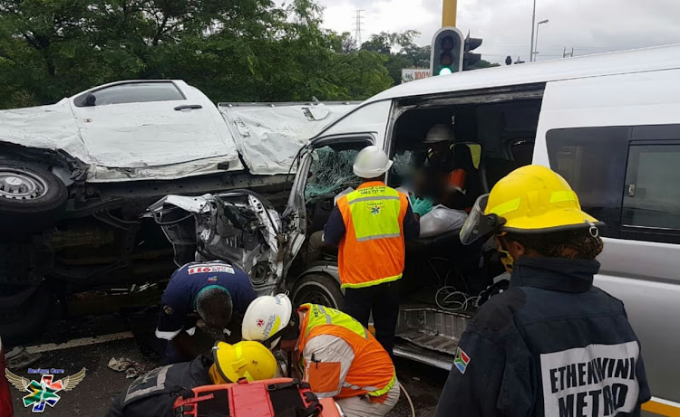 Paramedics try to stabilise the injured in the serious taxi crash outside Durban