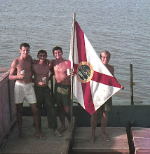 Photo: Coe, Crosby, Ammon, Sales showing off FL Flag ( the 1st 2 are pushing daisey's)