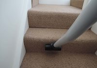 carpeted stairs being cleaned