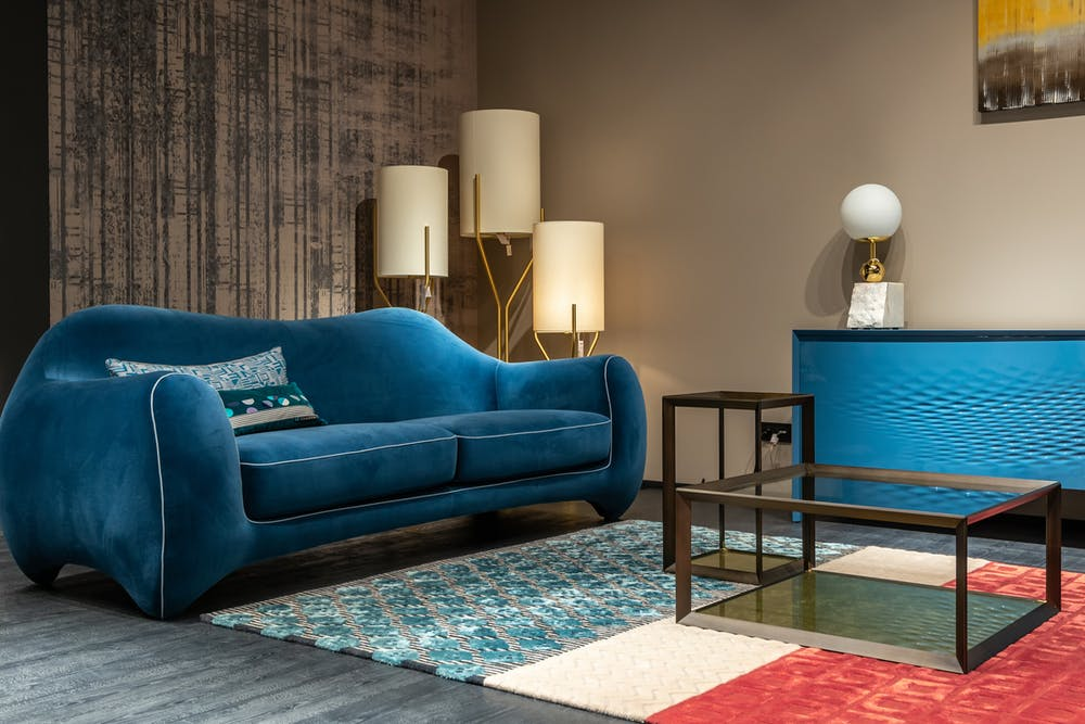 Living room with blue sofa and accessories; interior decorating rules, Michael Gainey Signature Designs